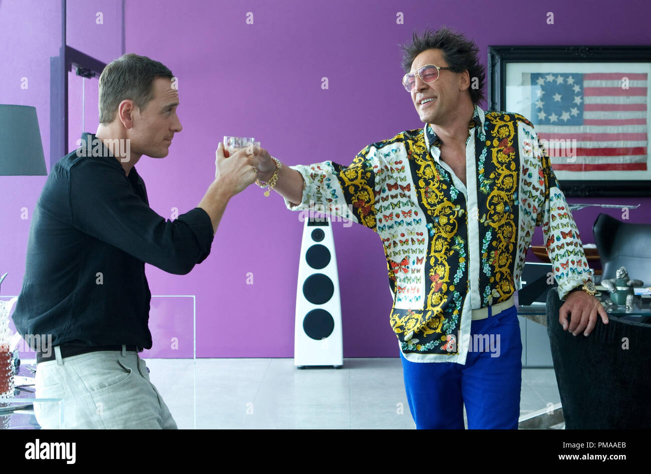 The Counselor (Michael Fassbender, left) and Reiner (Javier Bardem) toast their deal unaware that they will soon pay a heavy price for it. - Stock Image