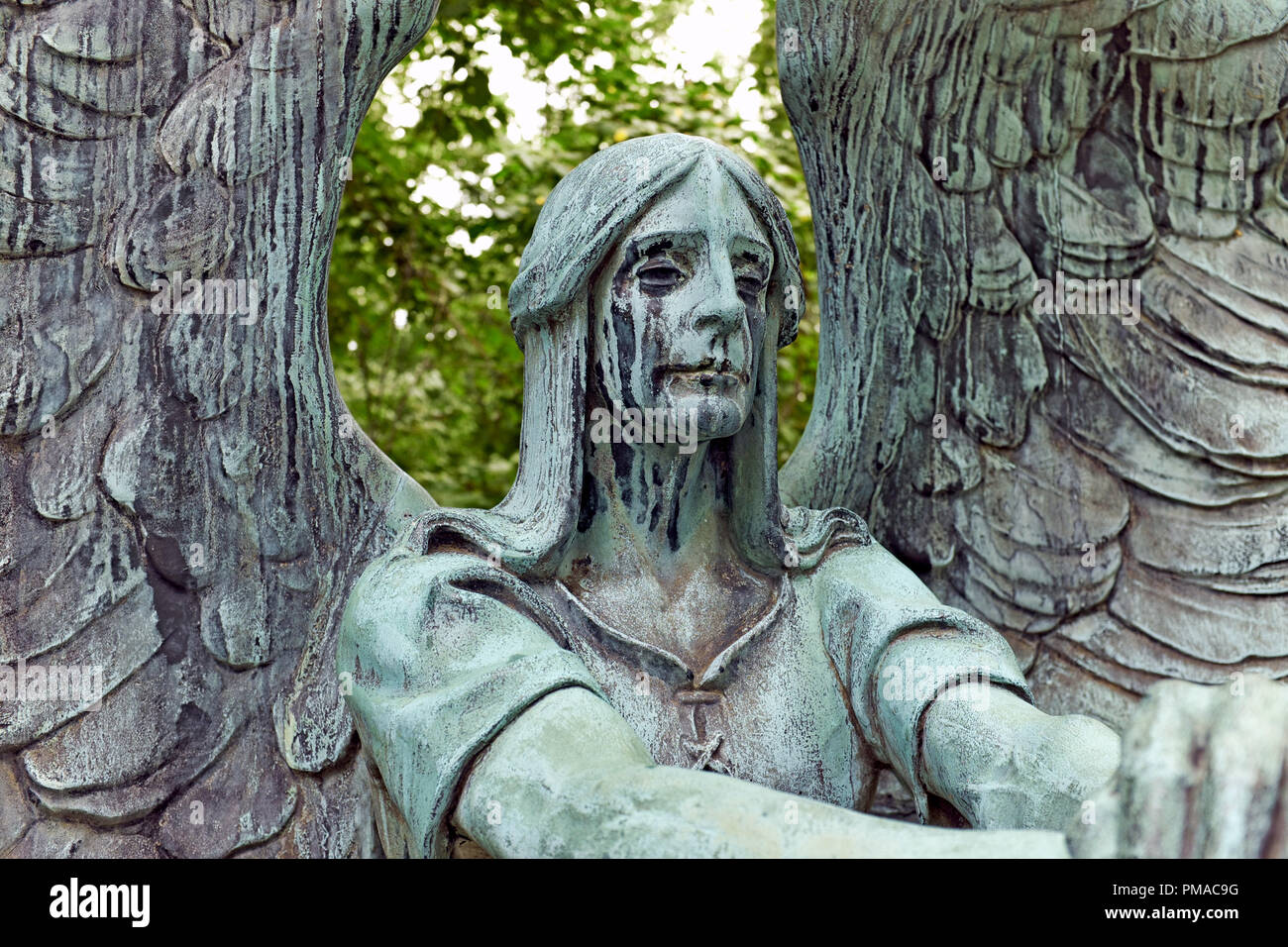 The 'Angel of Death Victorious' by Herman Matzen is a bronze sculpture upon a grave in Lake View Cemetery in Cleveland, Ohio, USA. - Stock Image
