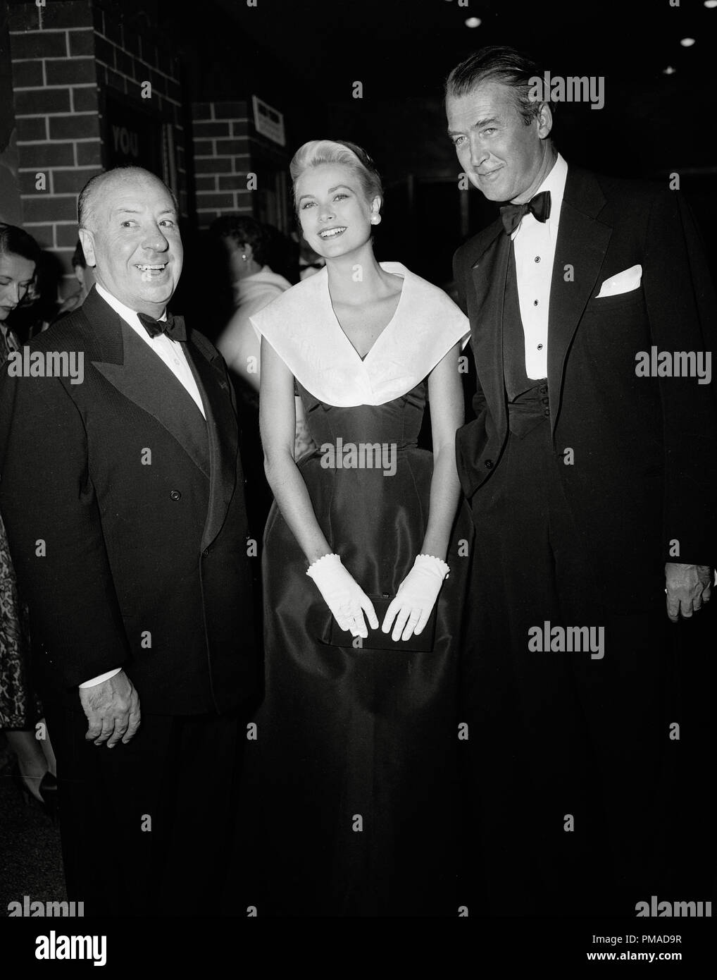 Alfred Hitchcock, Grace Kelly, James Stewart doing PR for 'Rear Window' circa 1954  File Reference # 32368_712THA - Stock Image
