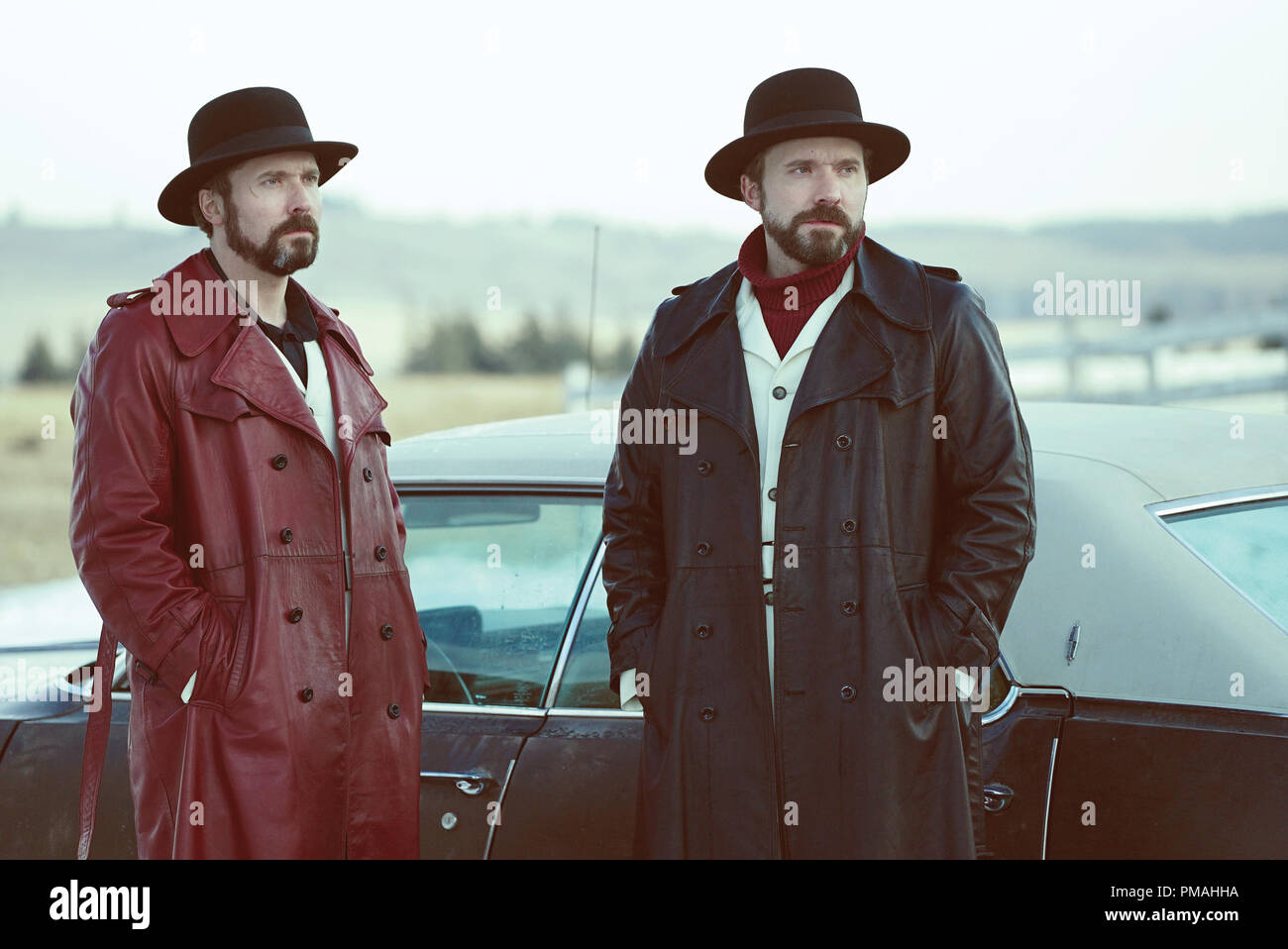 FARGO -- 'Before The Law' -- Episode 202 (Airs October 19, 10:00 pm e/p) Pictured: (l-r) Brad Mann as Gale Kitchen, Todd Mann as Wayne Kitchen. - Stock Image