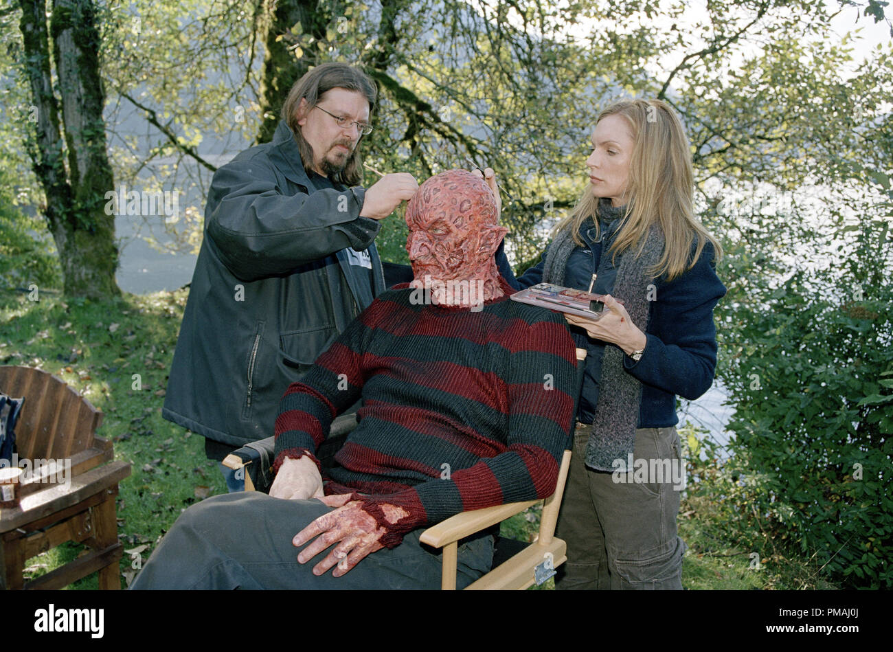 Robert Englund (seated) has his make-up touched up during on the set of New Line Cinema's ultimate showdown, FREDDY VS. JASON. 2003 - Stock Image