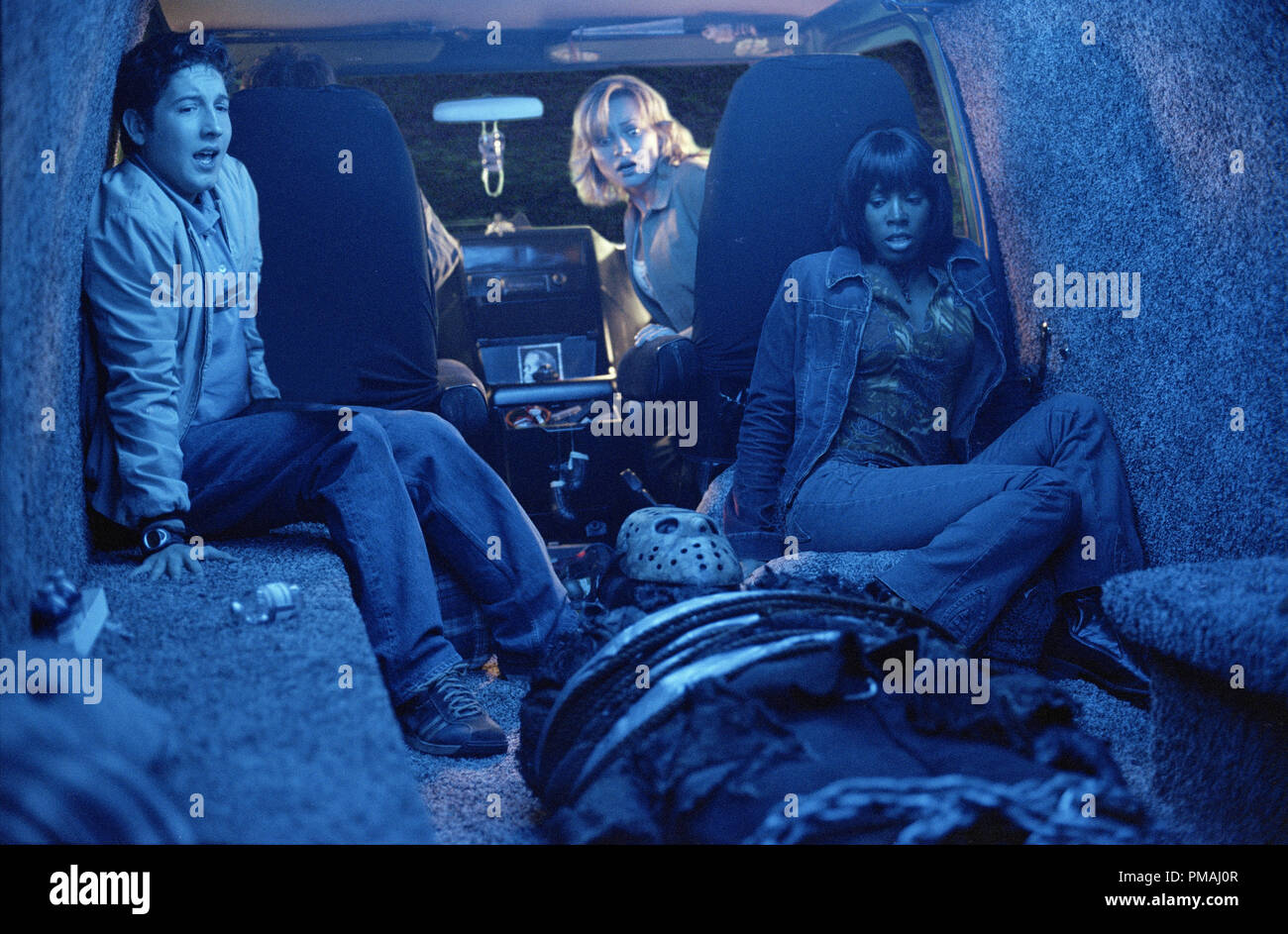 (left to right) Linderman (Christopher George Marquette), Lori (Monica Keena) and Kia (Kelly Rowland) know that Jason (Ken Kirzinger) cannot stay tied up for long in New Line Cinema's ultimate showdown, FREDDY VS. JASON. 2003 - Stock Image