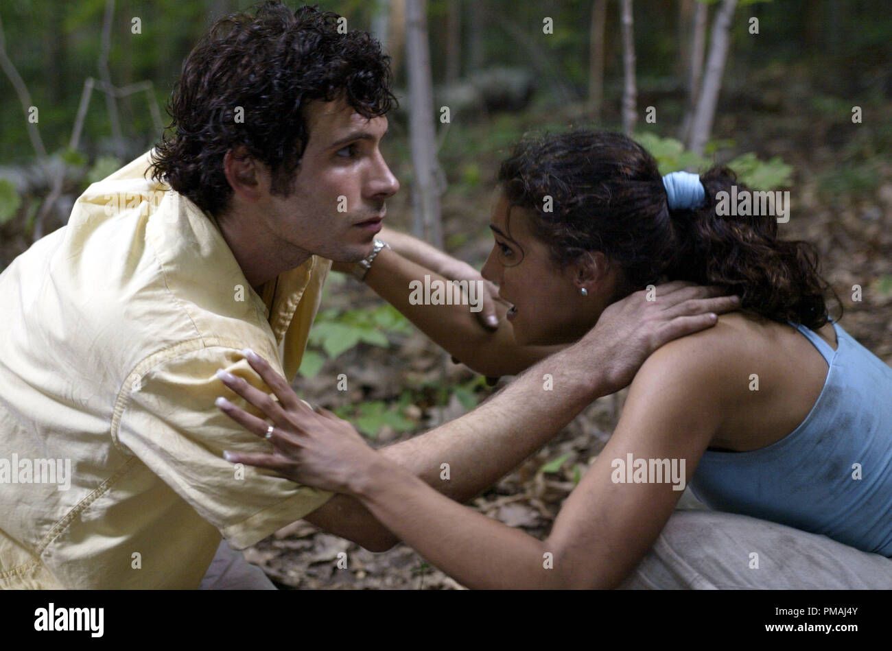 "In the midst of unspeakable horror, Scott (Jeremy Sisto, left) and Carly (Emmanuelle Chriqui) make an effort to console one another.  ""Wrong Turn"" (2003) Stock Photo"
