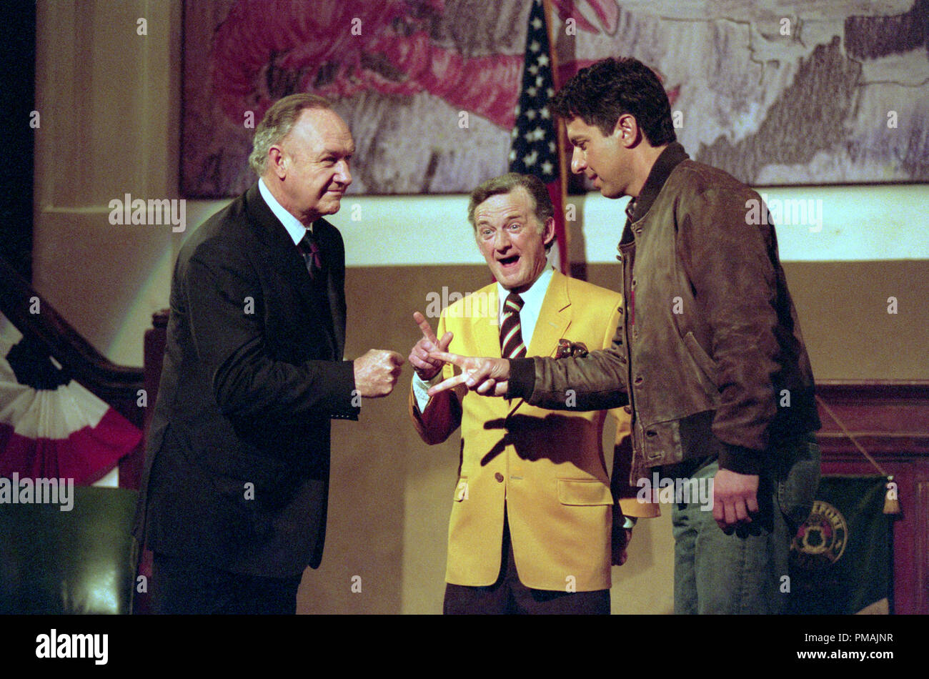 A game of 'Rock/Paper/Scissors' decides who goes first in a crucial mayoral debate between Cole (Gene Hackman, left) and Handy (Ray Romano), as town elder Morris Gutman (Wayne Robson) officiates in WELCOME TO MOOSEPORT. (2004) - Stock Image