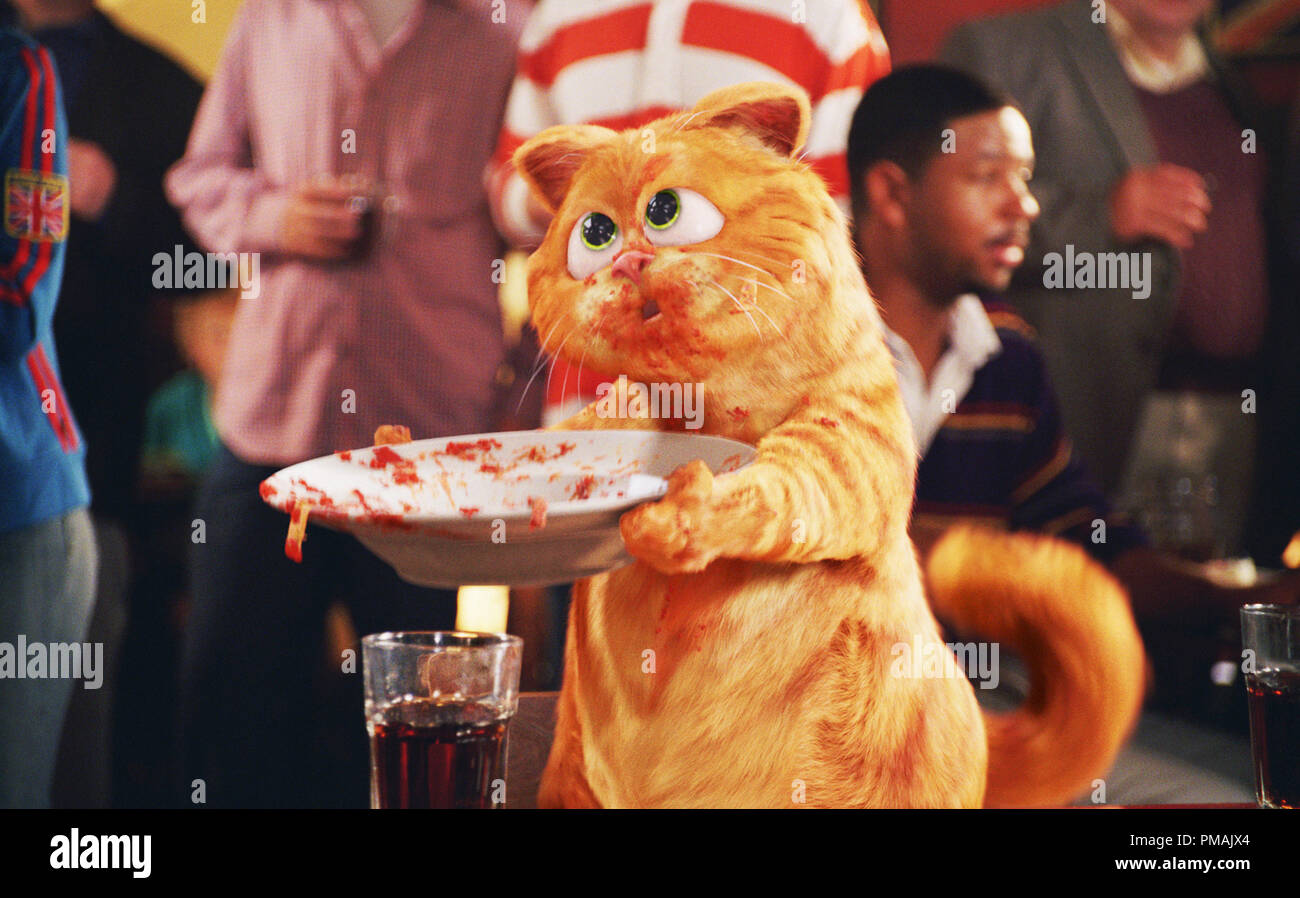 Garfield's look-alike Prince, a new convert to the joys of lasagna, invokes the spirit of Dickens' Oliver Twist, asking, 'Please sir, may I have some more.'  'GARFIELD: A TAIL OF TWO KITTIES' (2006) Twentieth Century Fox. - Stock Image