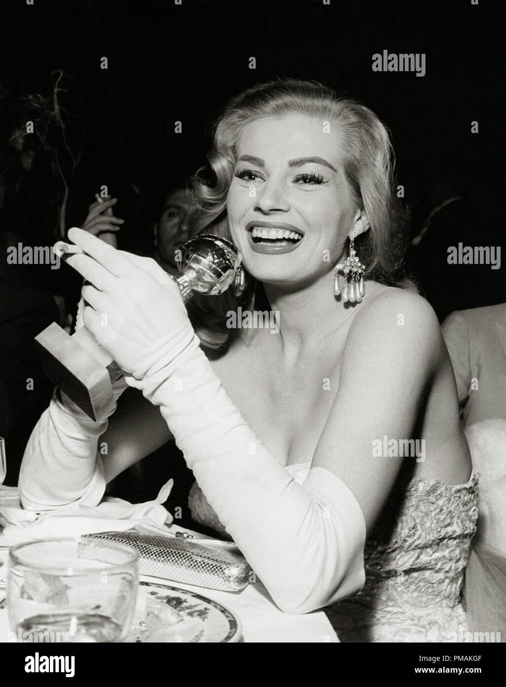 Anita Ekberg with her Golden Globe award (New Star of the Year Actress)  during the 13th Golden Globe Awards held at the Cocoanut Grove Nightclub in Los Angeles, CA, February 23, 1956  File Reference # 33300_505THA - Stock Image