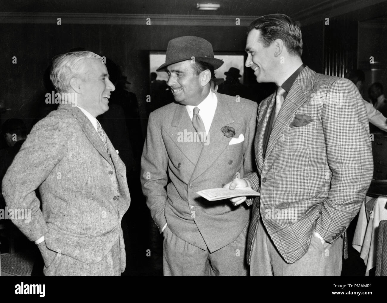 Charles Chaplin, Douglas Fairbanks Sr. and  Douglas Fairbanks Jr., 1939  File Reference # 33505_006THA - Stock Image