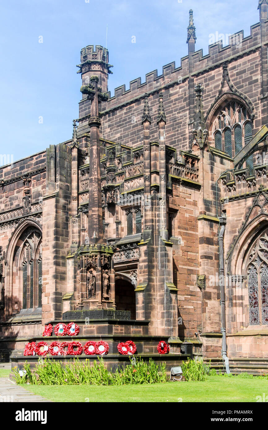 Remembrance day poppy wreaths on memorial, Chester cathedral, England. - Stock Image