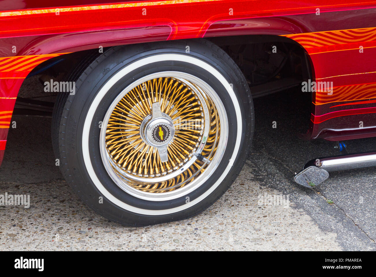 Closeup of wheel on Chevy hot rod. - Stock Image