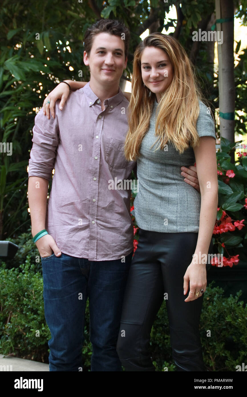 """Shailene Woodley and Miles Teller   """"The Spectacular Now"""" Portrait Session, July 29, 2013. Reproduction by American tabloids is absolutely forbidden. File Reference # 32075 030JRC  For Editorial Use Only -  All Rights Reserved Stock Photo"""