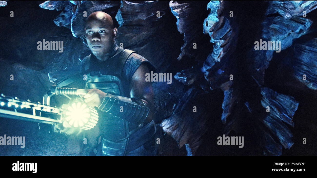 """Moss (BOKEEM WOODBINE) is a merc hunting Riddick--a dangerous, escaped convict wanted by every bounty hunter in the known galaxy--in """"Riddick"""", the latest chapter of the groundbreaking saga that began with the hit sci-fi film """"Pitch Black"""". Stock Photo"""