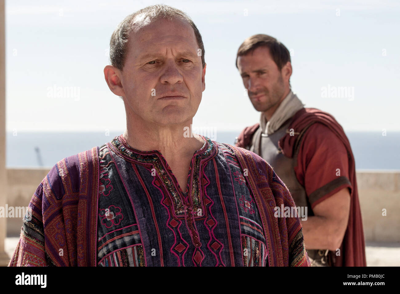Pontius Pilate (Peter Firth) worries aloud that the prophecy of the Messiah may prove true as his tribune Clavius (Joseph Fiennes) awaits marching orders in Columbia Pictures' RISEN, in theaters nationwide Feb. 19, 2016. - Stock Image