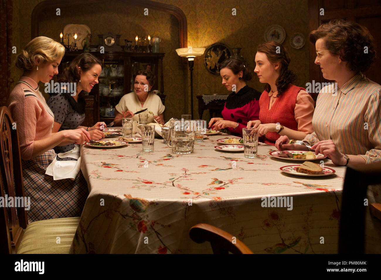 Emily Bett Rickards as 'Patty,' Eve Macklin as 'Diana,' Julie Walters as 'Mrs. Kehoe,' Nora-Jane Noone as 'Sheila' and Saiorse Ronan as 'Eilis' in BROOKLYN. © 2015 Twentieth Century Fox Film Corporation All Rights Reserved - Stock Image