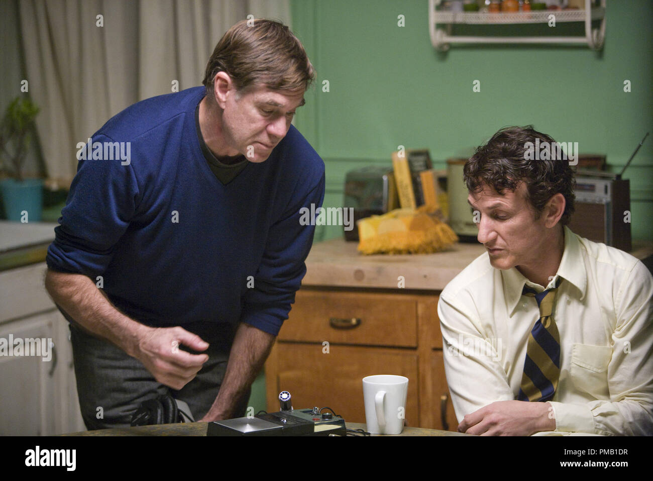 """Director Gus Van Sant (left) and Sean Penn (right) on the set of MILK, a Focus Features release.  """"Milk"""" (2008) Focus Features Stock Photo"""