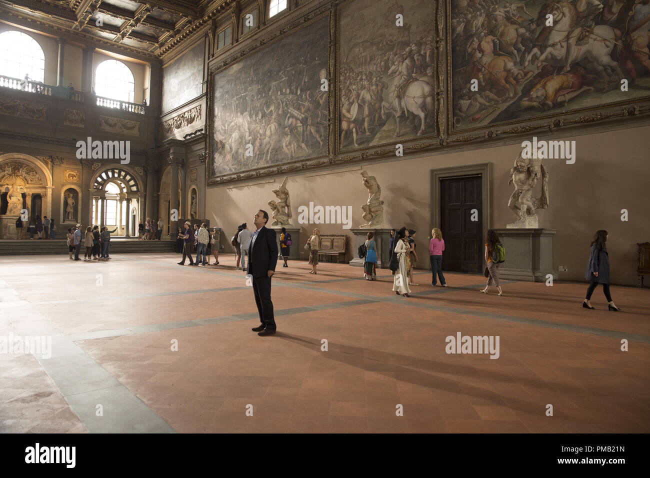 Robert Langdon (Tom Hanks) in the Hall of 500, Palazzo Vecchio, Florence in Columbia Pictures' INFERNO. - Stock Image