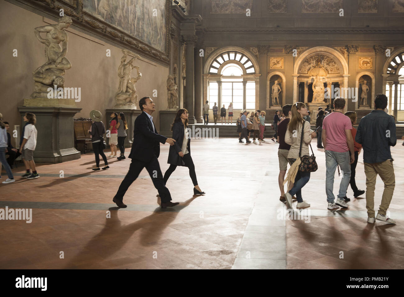 Langdon (Tom Hanks) and Sienna (Felicity Jones) arrive at the Hall of 500 in Columbia Pictures' INFERNO. - Stock Image