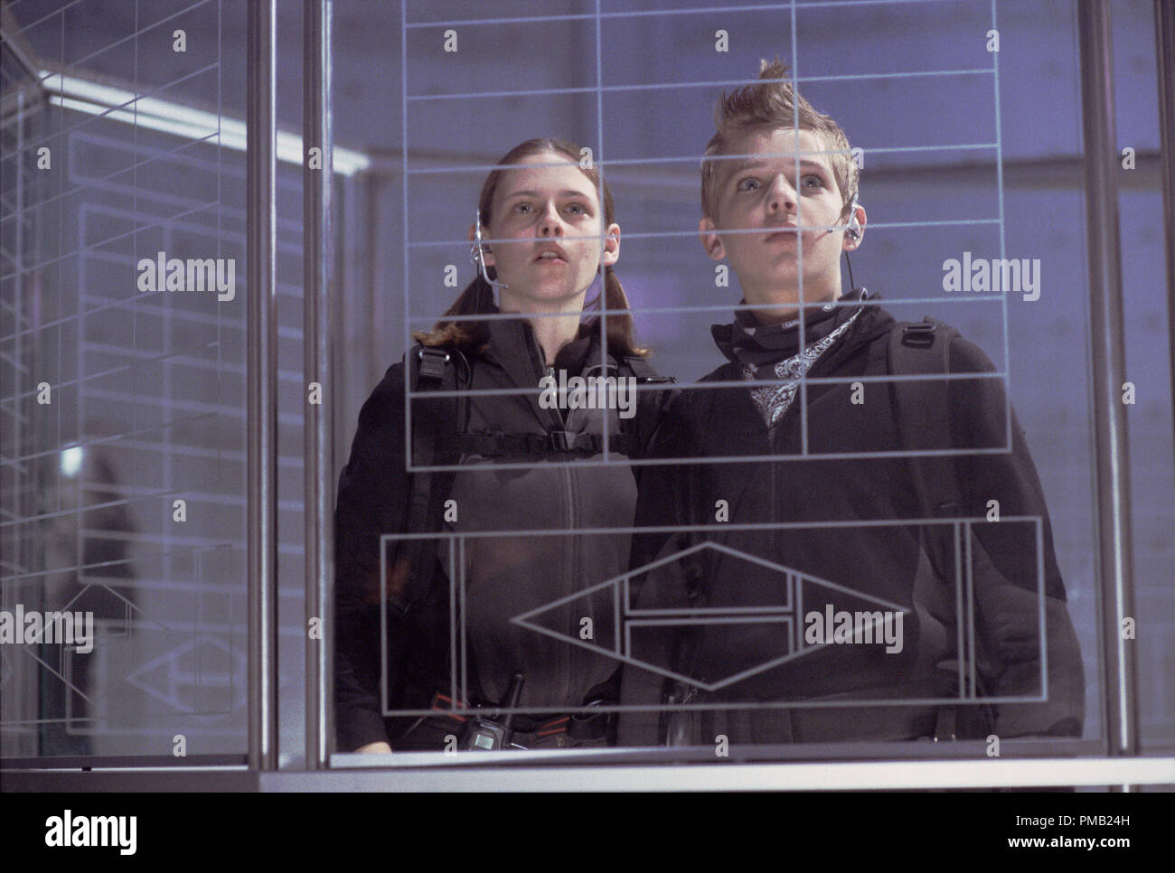 Kristen Stewart and Max Thieriot face some high-tech challenges in their daring mission.  'Catch That Kid' (2003) - Stock Image