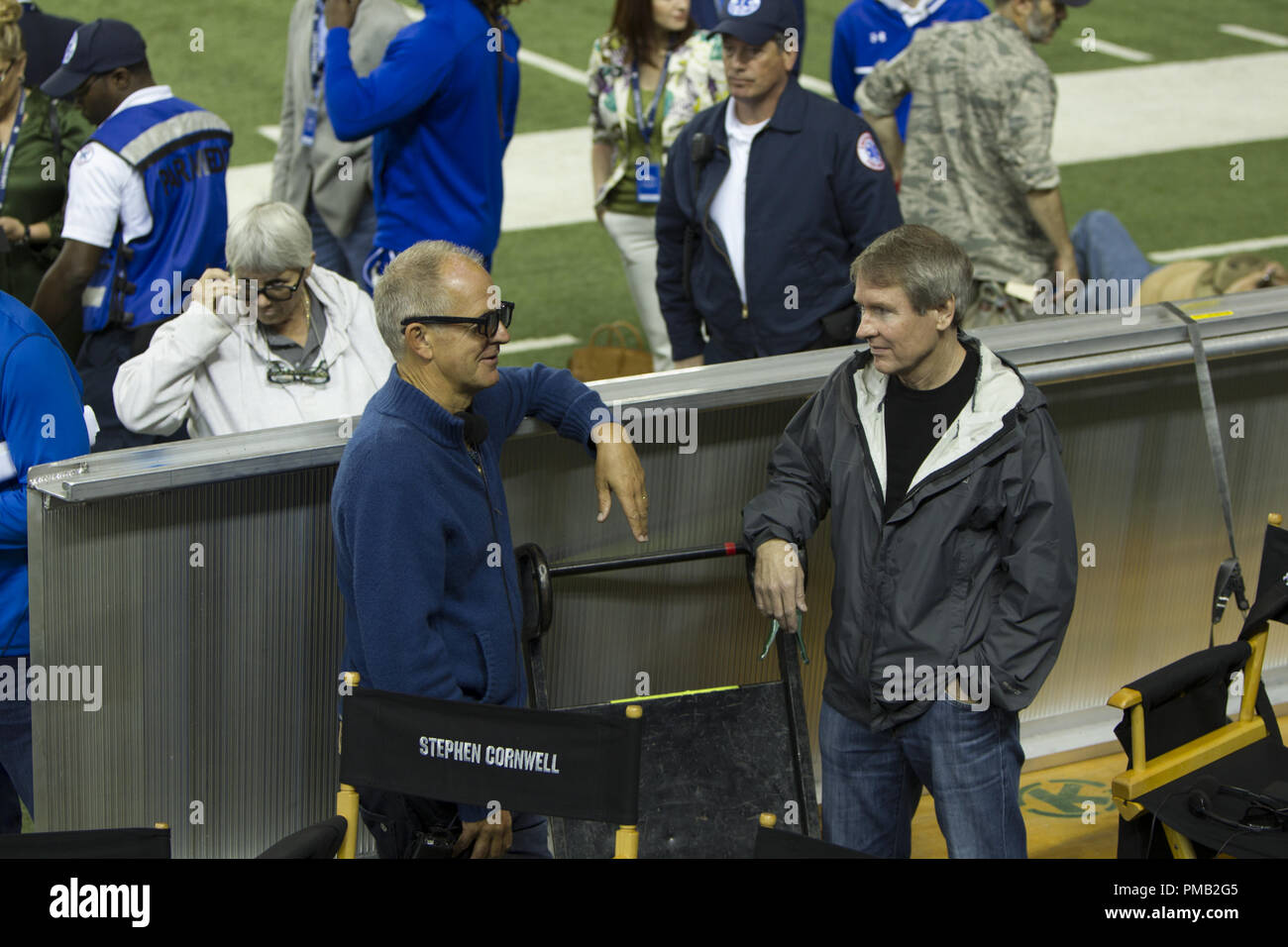 Producer Stephen Cornwell and book author Ben Fountain on the set of TriStar Pictures' BILLY LYNN'S LONG HALFTIME WALK. - Stock Image