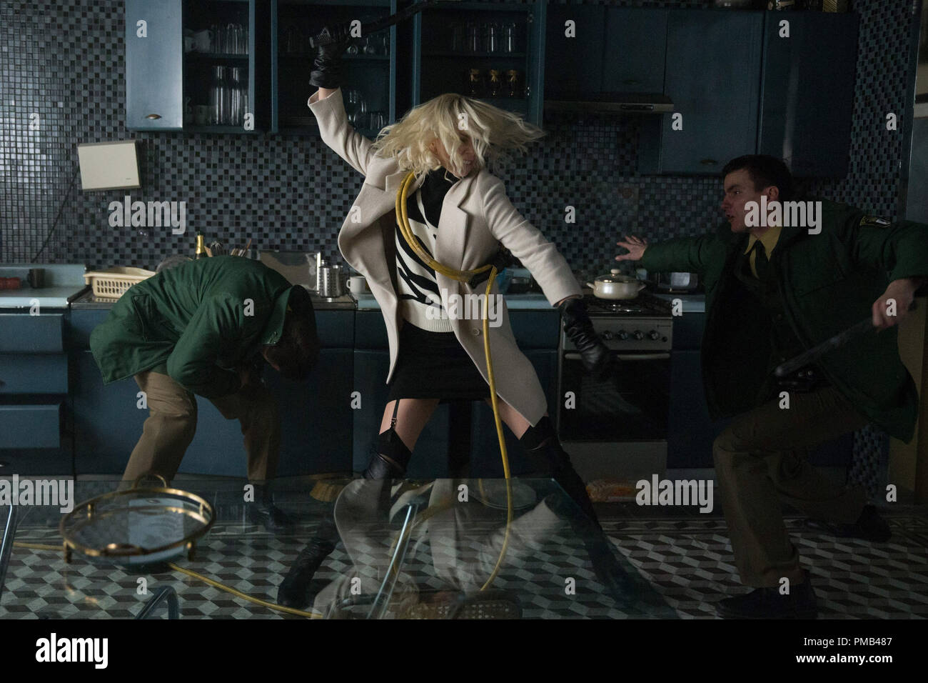 "CHARLIZE THERON explodes into summer in ""Atomic Blonde,"" a breakneck action-thriller that follows MI6's most lethal assassin through a ticking time bomb of a city simmering with revolution and double-crossing hives of traitors. (2017) Focus Features Stock Photo"