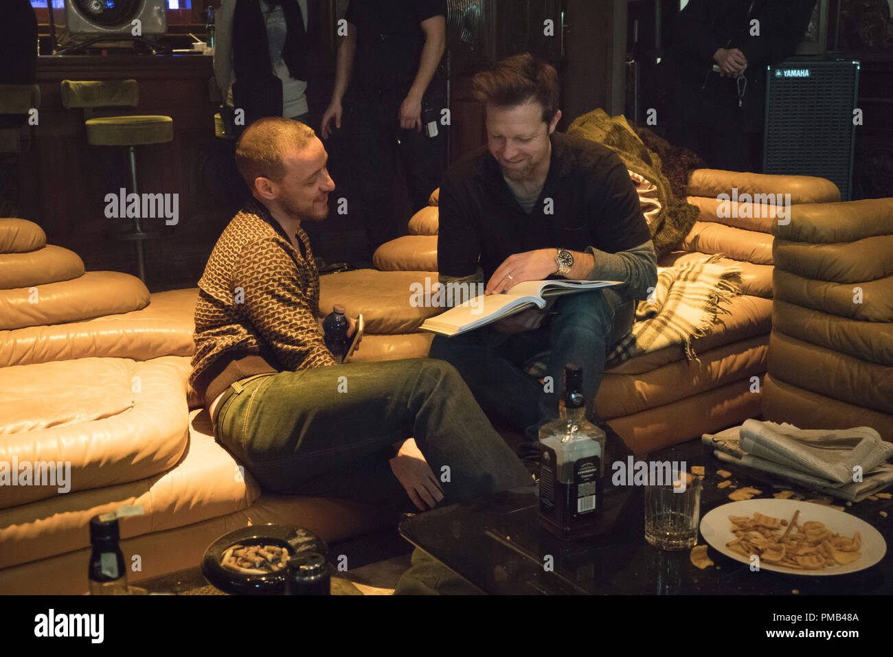 (L to R) JAMES MCAVOY as David Percival and director DAVID LEITCH on the set of 'Atomic Blonde.'  (2017) Focus Features - Stock Image