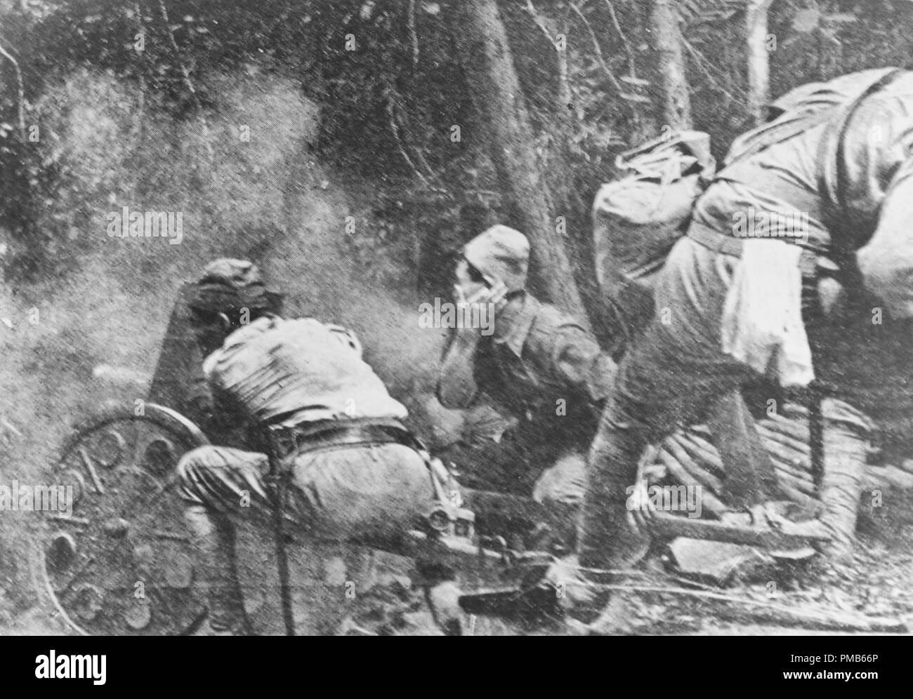 Small Japanese field gun in action, during the Bataan Campaign, April 1942. Copied from the Japanese book: 'Philippine Expeditionary Force,' published in 1943. Original Japanese caption: 'The pursuit of the enemy goes into its final stages. The shot, like the coupe de grace from the executioner's gun, is on its way. The enemy returns fire. The jungle is impenetrable.' - Stock Image