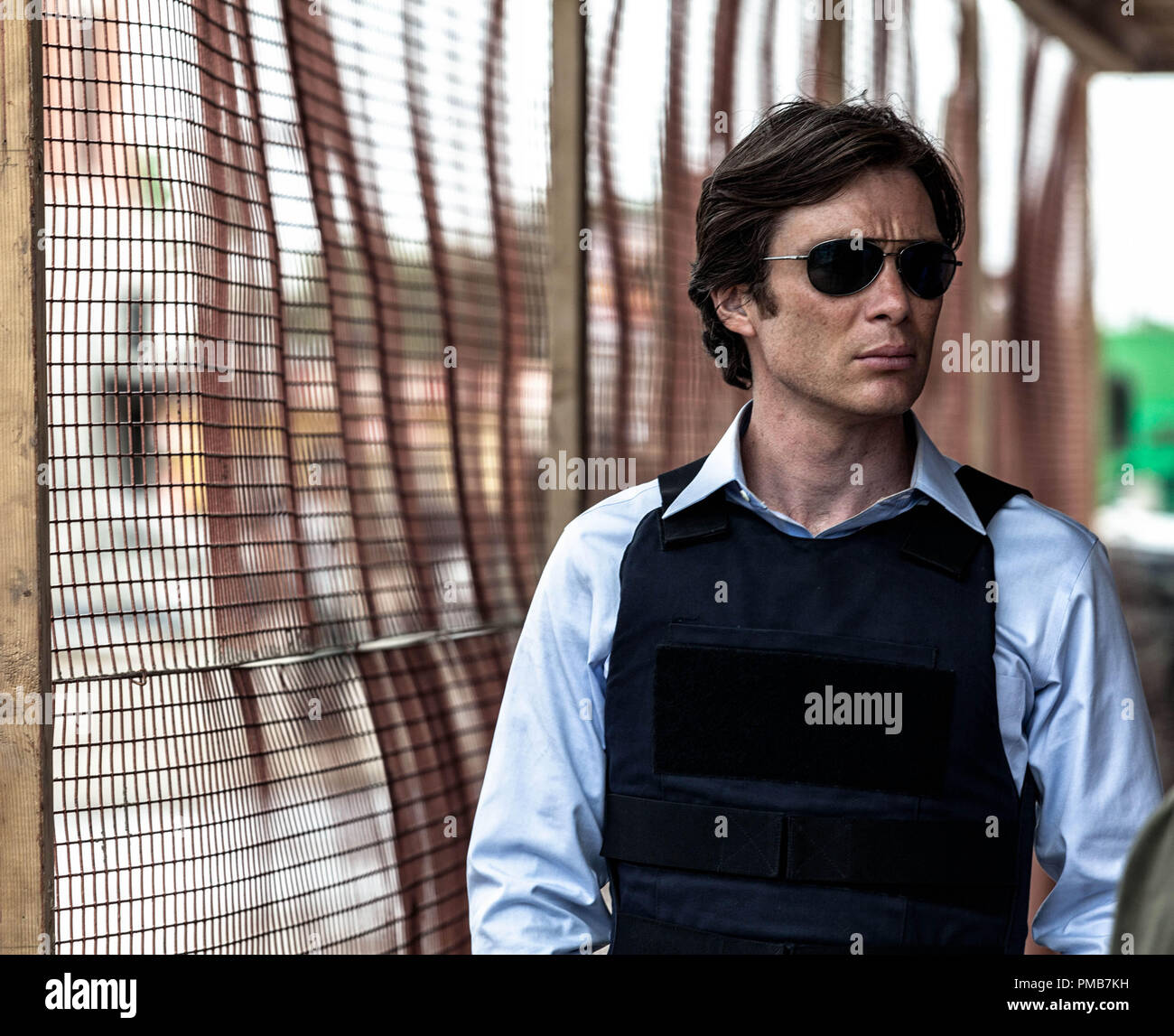 CILLIAN MURPHY as Agent Buchanan in Alcon Entertainment's sci-fi thriller 'TRANSCENDENCE,' a Warner Bros. Pictures release. - Stock Image