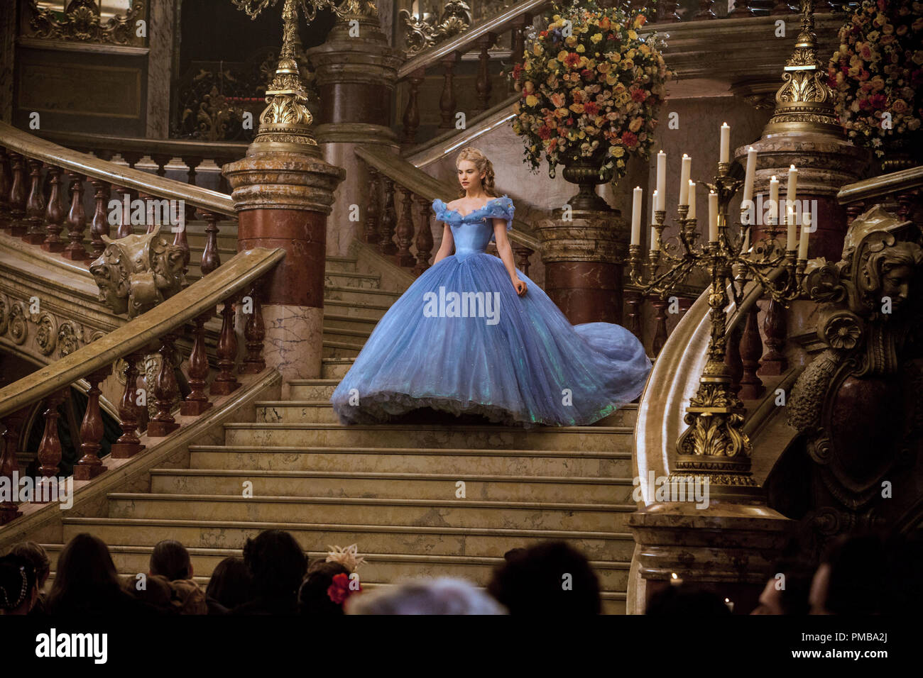 Lily James is Cinderella in CINDERELLA , a live-action feature which brings to life the timeless images from Disney's 1950 animated masterpiece as fully-realized characters in a visually dazzling spectacle for a whole new generaton. - Stock Image