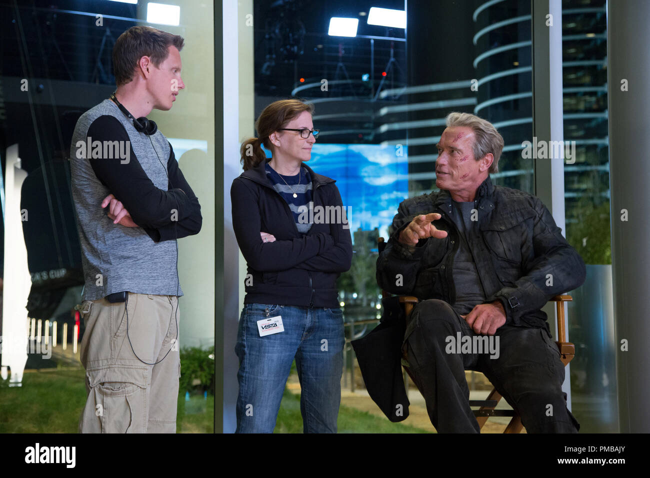 Left to right: Producer David Ellison, Producer Dana Goldberg, and Arnold Schwarzenegger on set of TERMINATOR GENISYS from Paramount Pictures and Skydance Productions. Stock Photo