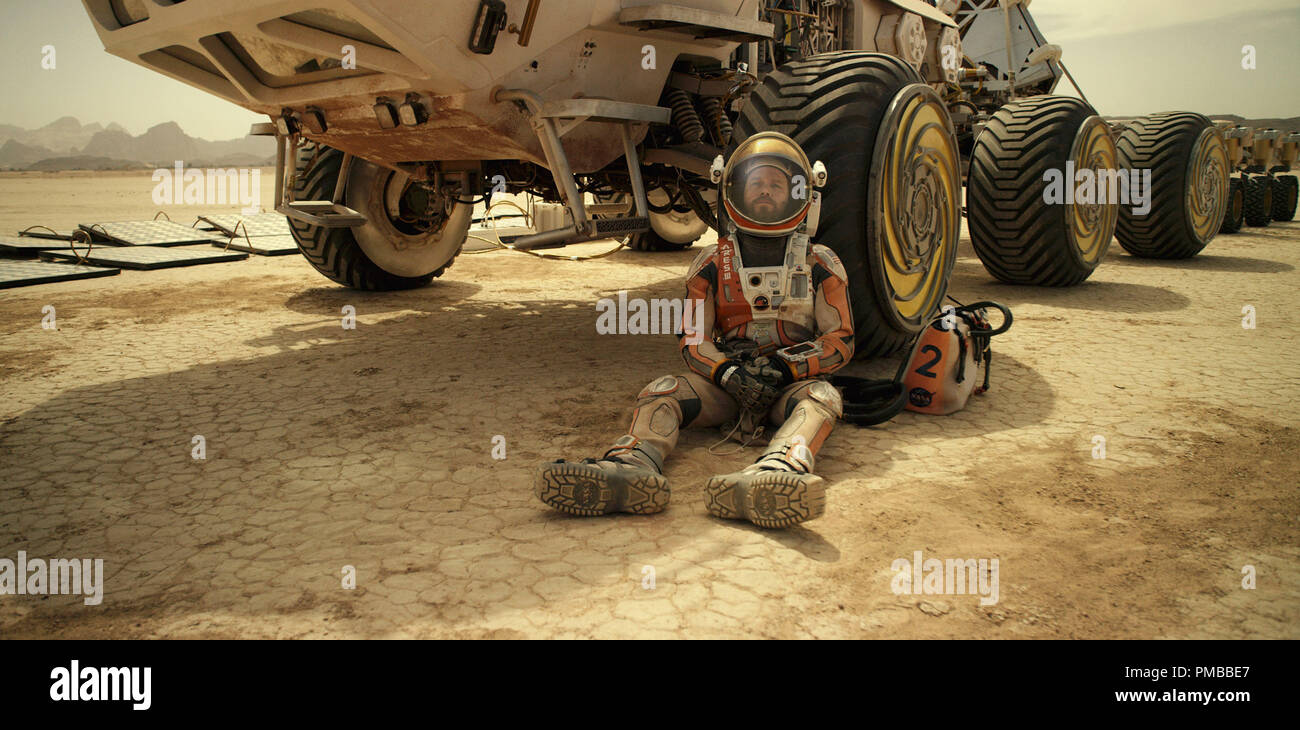 Matt Damon portrays an astronaut who faces seemingly insurmountable odds as he tries to find a way to subsist on a hostile planet in THE MARTIAN. - Stock Image