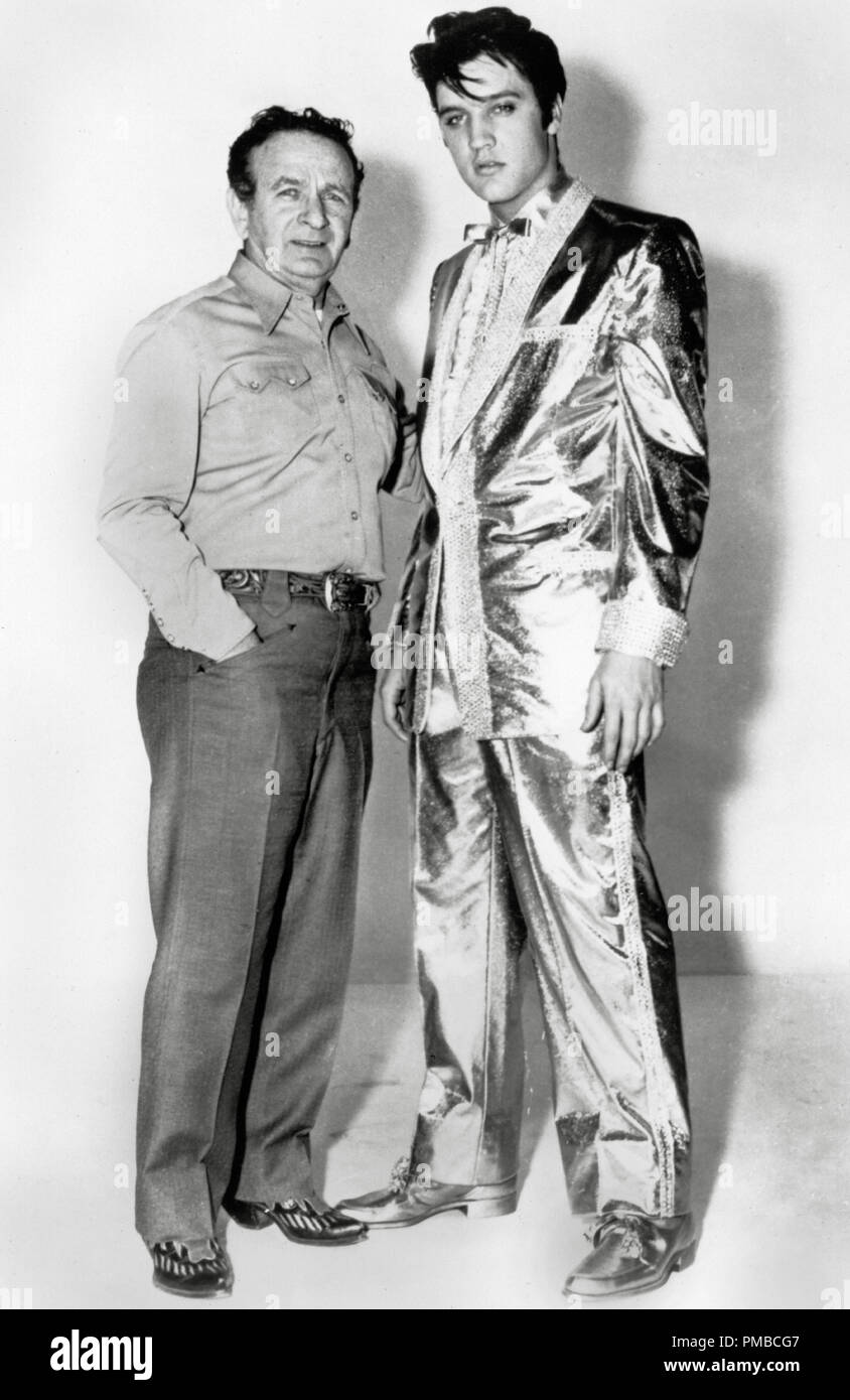 Fashion designer Nudie Cohn and Elvis Presley in his $10,000 gold lamé suit, worn by the singer on the cover of his '50,000,000 Elvis Fans Can't Be Wrong' album, circa 1959. File Reference # 32914_736THA - Stock Image