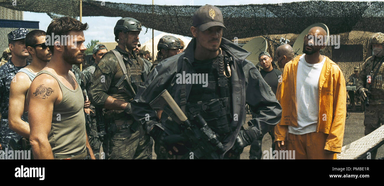 (L-r) SCOTT EASTWOOD as Lieutenant GQ Edwards, JOEL KINNAMAN as Rick Flag and WILL SMITH as Deadshot in Warner Bros. Pictures' action adventure 'SUICIDE SQUAD,' a Warner Bros. Pictures release. - Stock Image