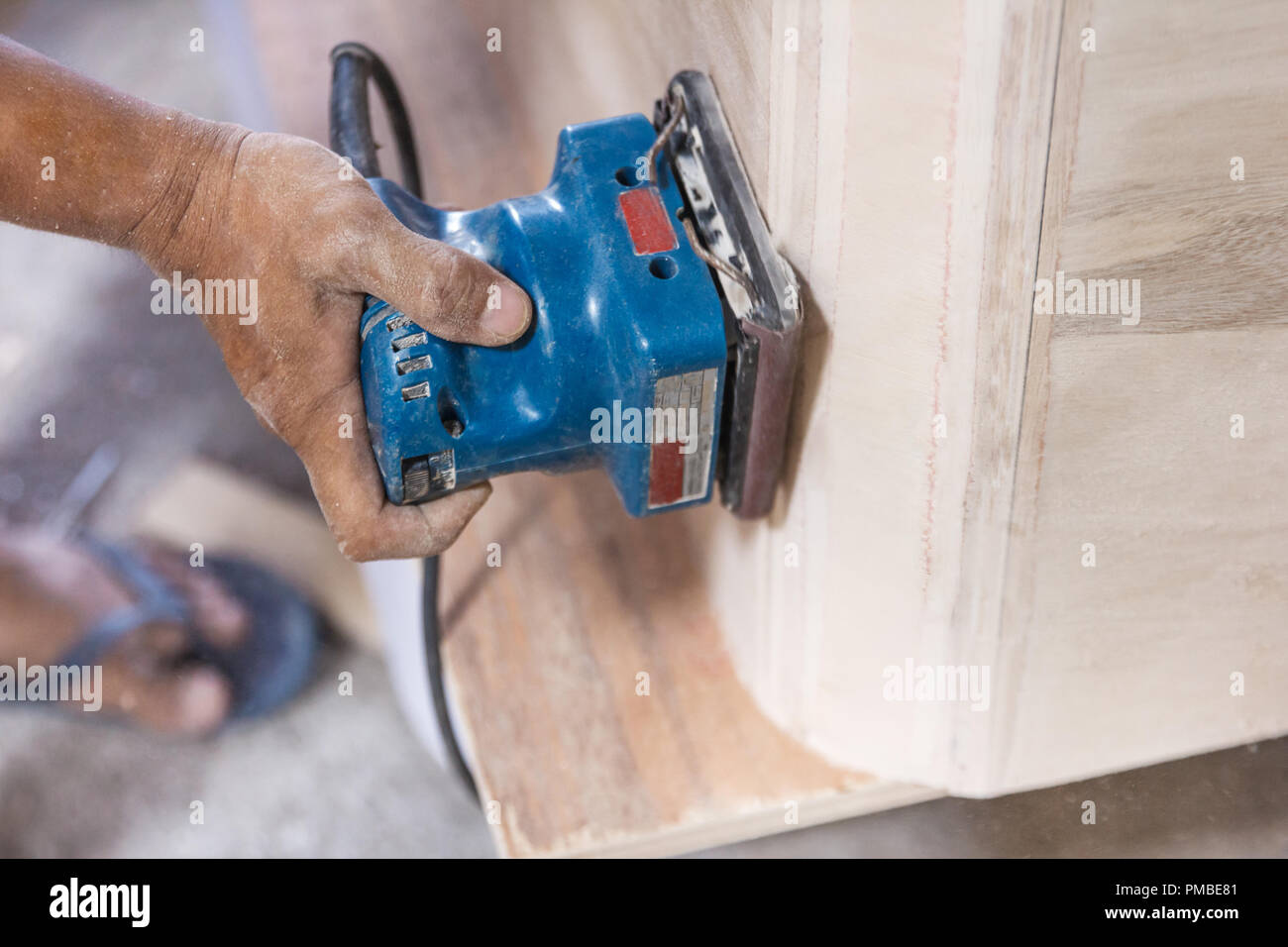 workers hands at carpenter workspace refining the surface of woo Stock Photo