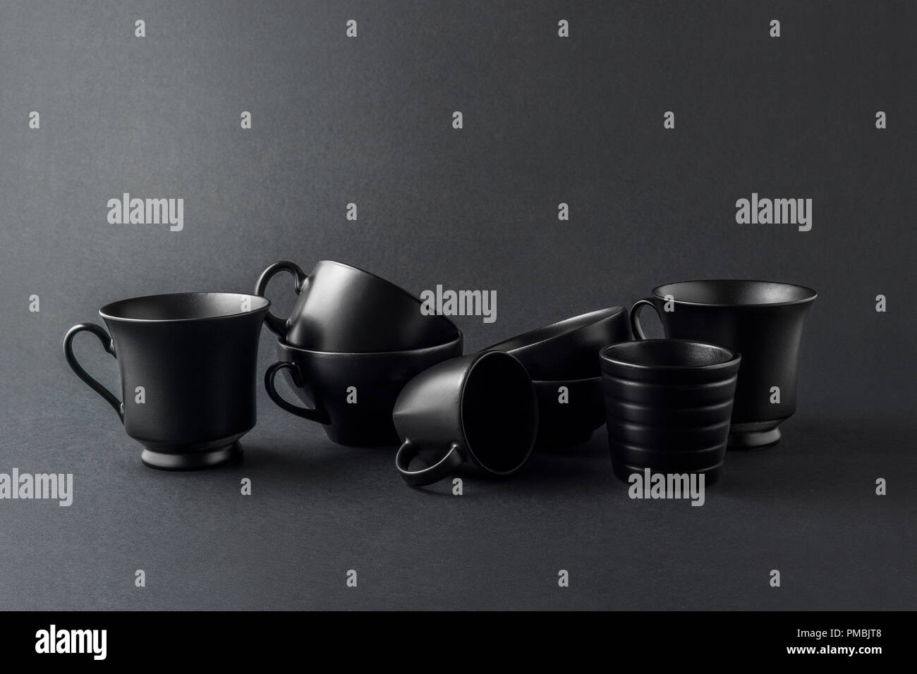 Creative Concept Photo Of Kitchenware Painted Cups And Mugs On Black Background Stock Photo Alamy