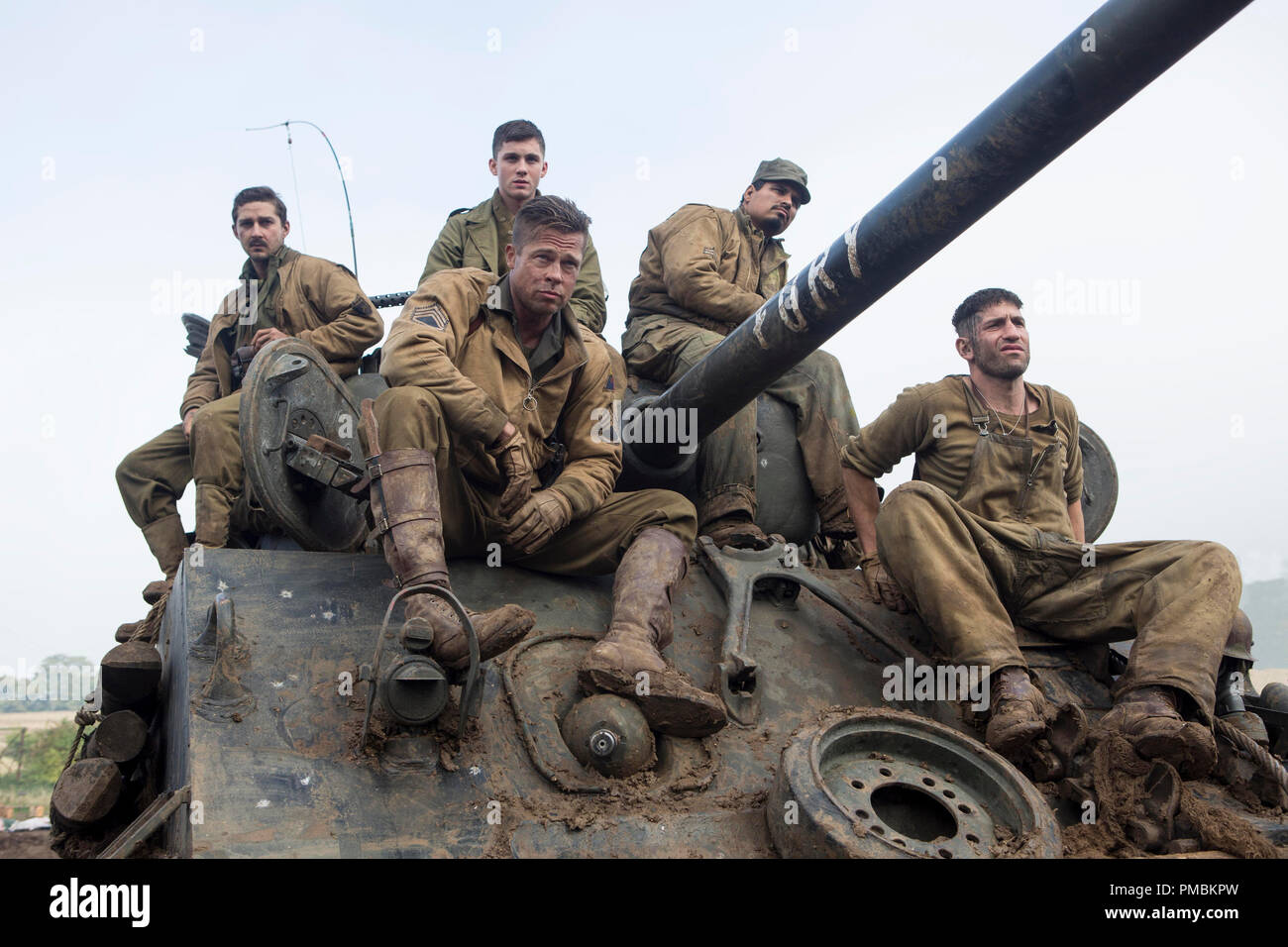 Don 'Wardaddy' Collier (Brad Pitt, centered) and his men Boyd Swan (Shia LaBeouf), Norman Ellison (Logan Lerman), Trini Garcia (Michael Peña) and Grady Travis (Jon Bernthal) in Columbia Pictures' FURY. - Stock Image