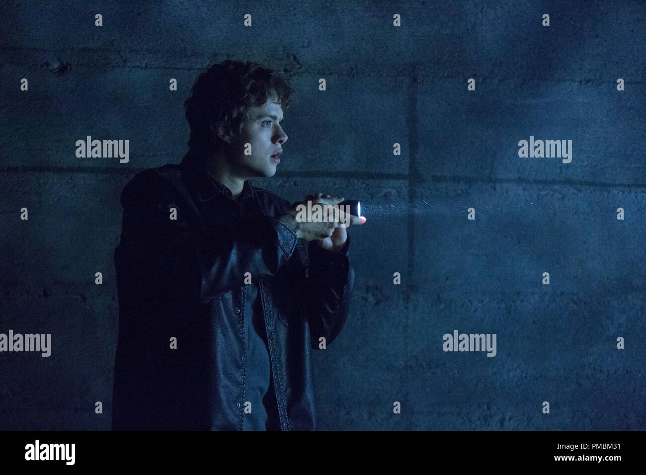 DOUGLAS SMITH stars as Pete in 'Ouija', a supernatural thriller about a group of friends who must confront their most terrifying fears when they awaken the dark powers of an ancient spirit board. - Stock Image