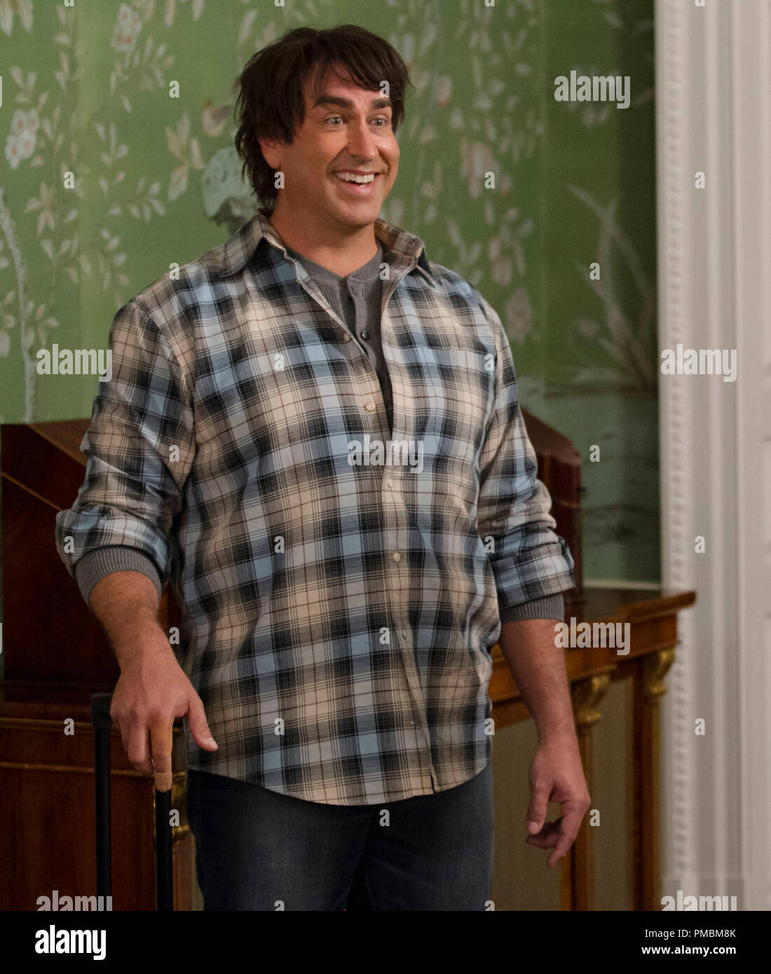 ROB RIGGLE stars as Travis in the sequel to the smash hit that took the physical comedy and kicked it in the nuts: 'Dumb and Dumber To'. - Stock Image