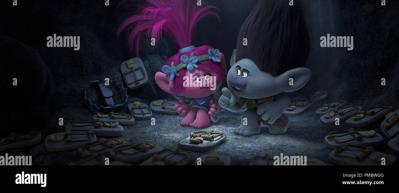 Troll princess Poppy (Left; voiced by Anna Kendrick) is introduced to overly cautious paranoid survivalist Branch's (Right; voiced by Justin Timberlake) fear bunker in DreamWorks Animation's TROLLS. - Stock Image