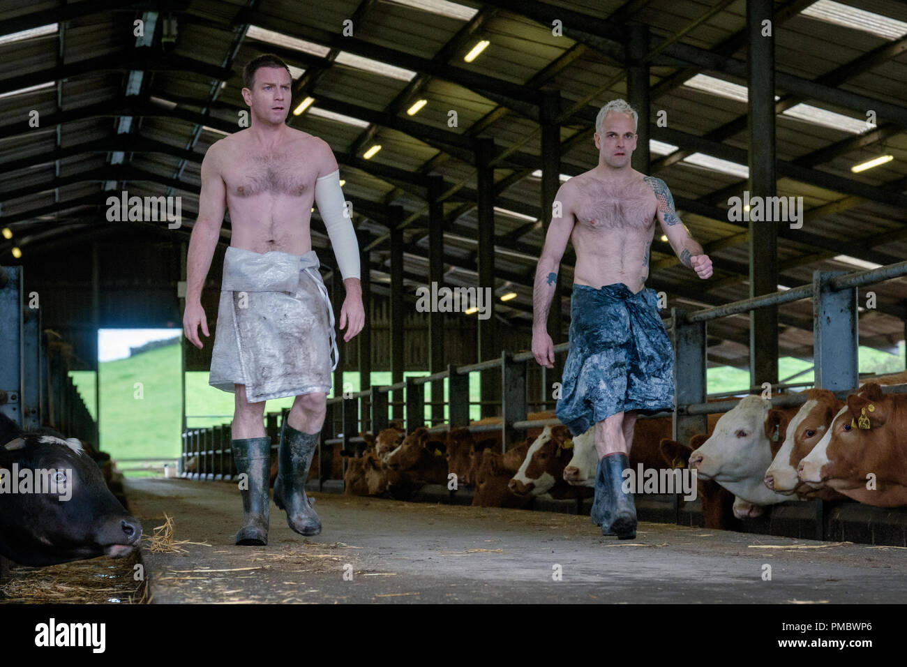 Mark renton ewan mcgregor and simon jonny lee miller striding out of cow barn in trisstar pictures t2 trainspotting 2017