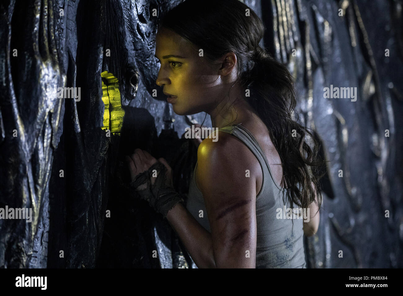 55237ac89 ALICIA VIKANDER as Lara Croft in Warner Bros. Pictures  and  Metro-Goldwyn-Mayer Pictures  action adventure