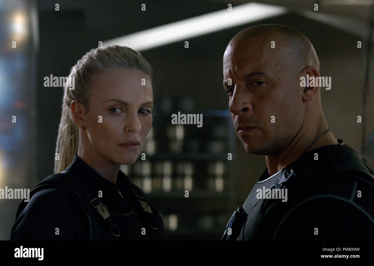 """Cipher (CHARLIZE THERON) recruits Dom (VIN DIESEL) in """"The Fate of the Furious"""" (2017) Stock Photo"""