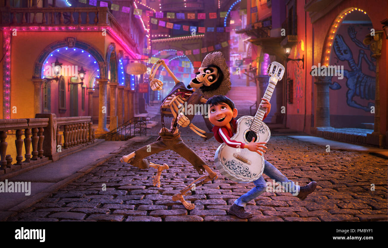"""NAME THAT TUNE – In Disney/Pixar's """"Coco,"""" Miguel's love of music ultimately leads him to the Land of the Dead where he teams up with charming trickster Hector. """"Coco"""" features an original score from Oscar®-winning composer Michael Giacchino, the original song """"Remember Me"""" by Kristen Anderson-Lopez and Robert Lopez, and additional songs co-written by Germaine Franco and co-director/screenwriter Adrian Molina. Also part of the team is musical consultant Camilo Lara of the music project Mexican Institute of Sound. In theaters on Nov. 22, 2017. © 2017 Disney•Pixar. All Rights Reserved. - Stock Image"""