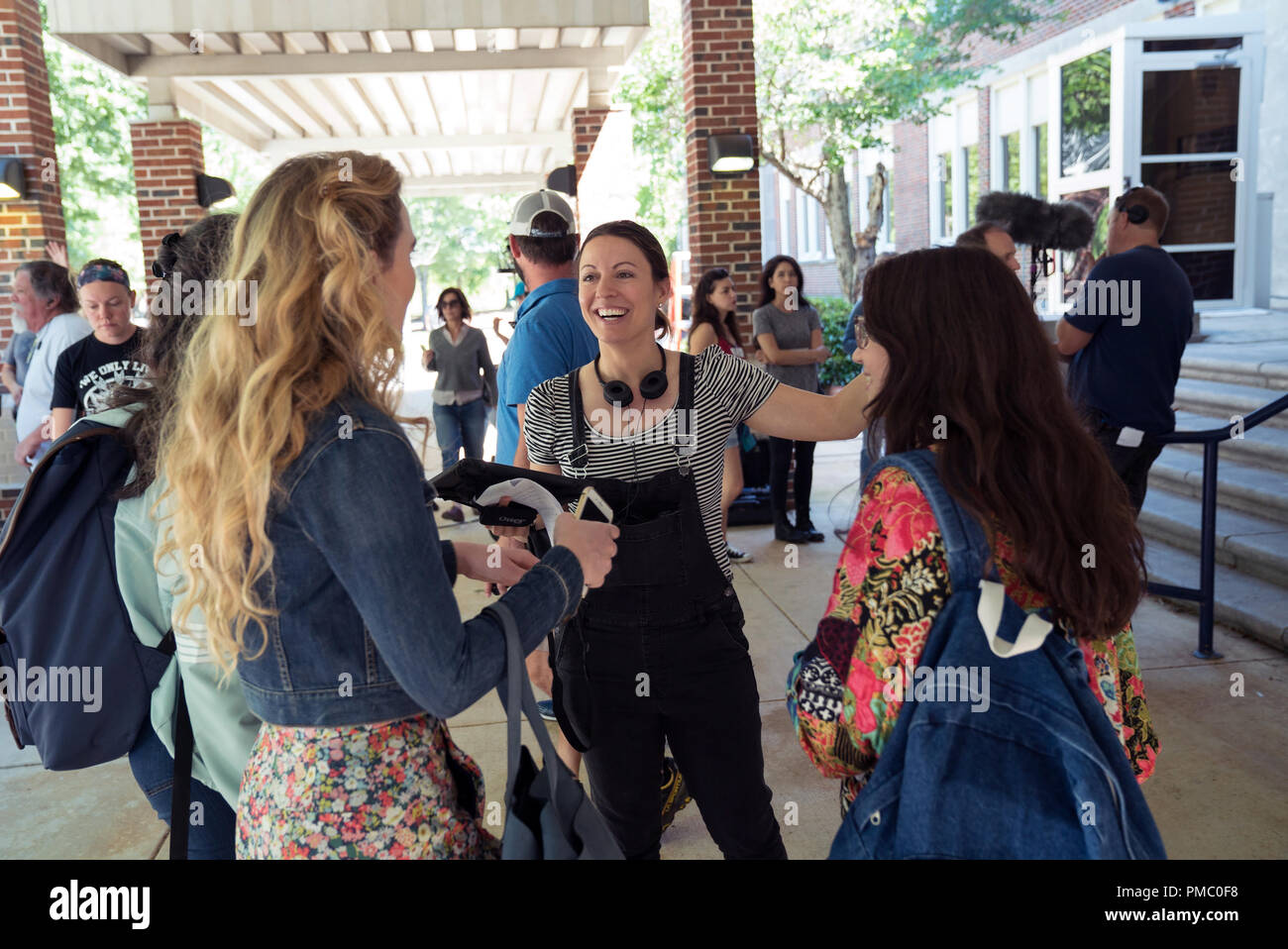 (L to R) GERALDINE VISWANATHAN as Kayla, KATHRYN NEWTON as Julie, director KAY CANNON and GIDEON ADLON as Sam on the set of 'Blockers,' the directorial debut of Cannon (writer of the 'Pitch Perfect' series).  When three parents discover their daughters' pact to lose their virginity at prom, they launch a covert one-night operation to stop the teens from sealing the deal. 2018 Universal Studios - Stock Image