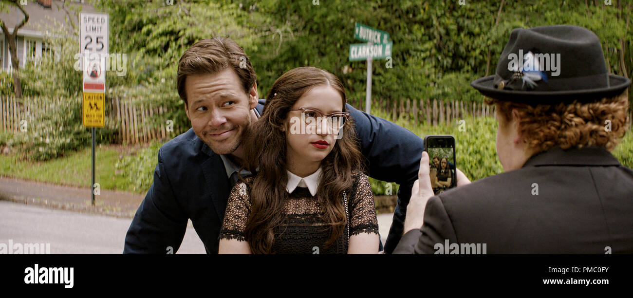 (L to R) Hunter (IKE BARINHOLTZ) with daughter Sam (GIDEON ADLON) and her date, Chad (JIMMY BELLINGER), in 'Blockers,' the directorial debut of Kay Cannon (writer of the 'Pitch Perfect' series).  When three parents discover their daughters' pact to lose their virginity at prom, they launch a covert one-night operation to stop the teens from sealing the deal. 2018 Universal Studios - Stock Image