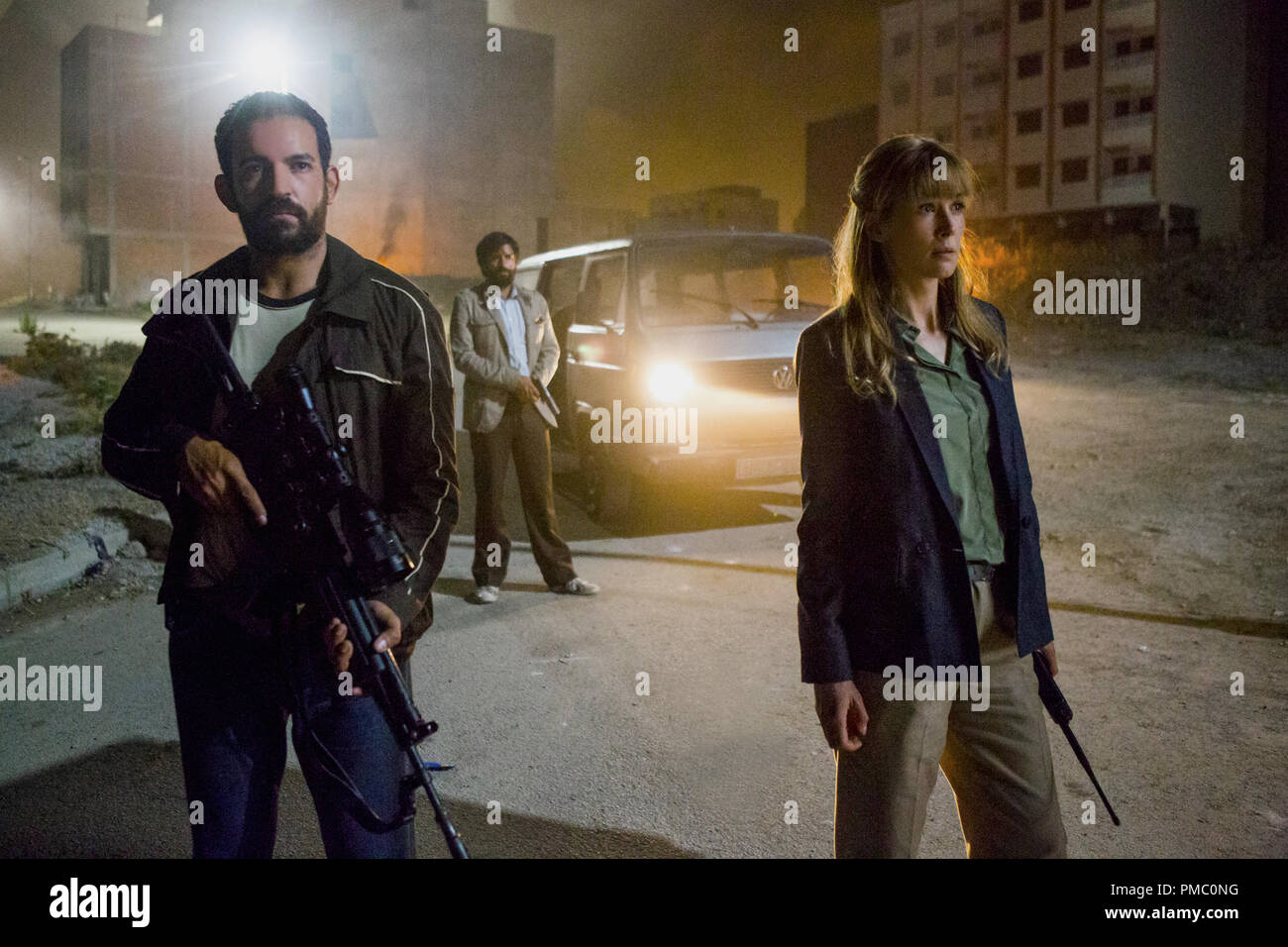 (right) Rosamund Pike stars as Sandy Crowder in director Brad Anderson's BEIRUT, a Bleecker Street release. (2018) Stock Photo