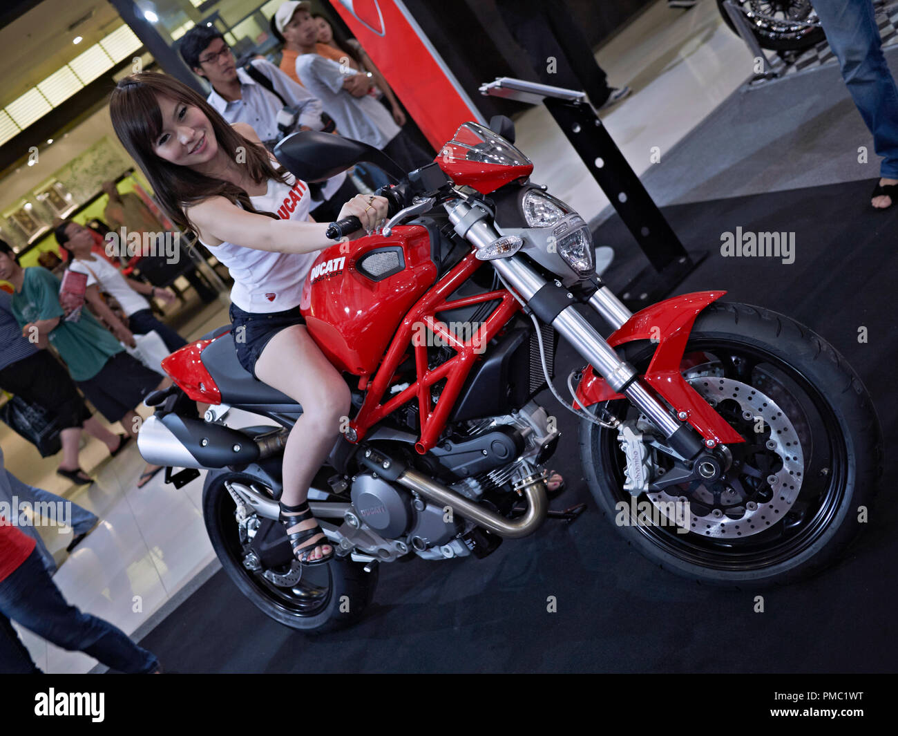 Ducati motorcycle and female model at the annual Bangkok motorcycle show. Thailand S. E. Asia - Stock Image