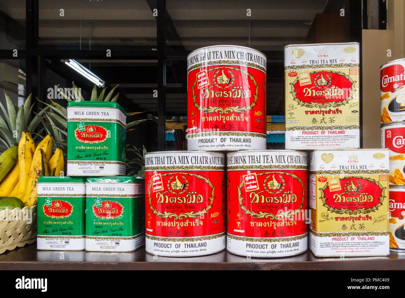 Phuket Town, Thailand - 6th August 2018: Tins of Thai tea. Milky tea is a popular drink. - Stock Image