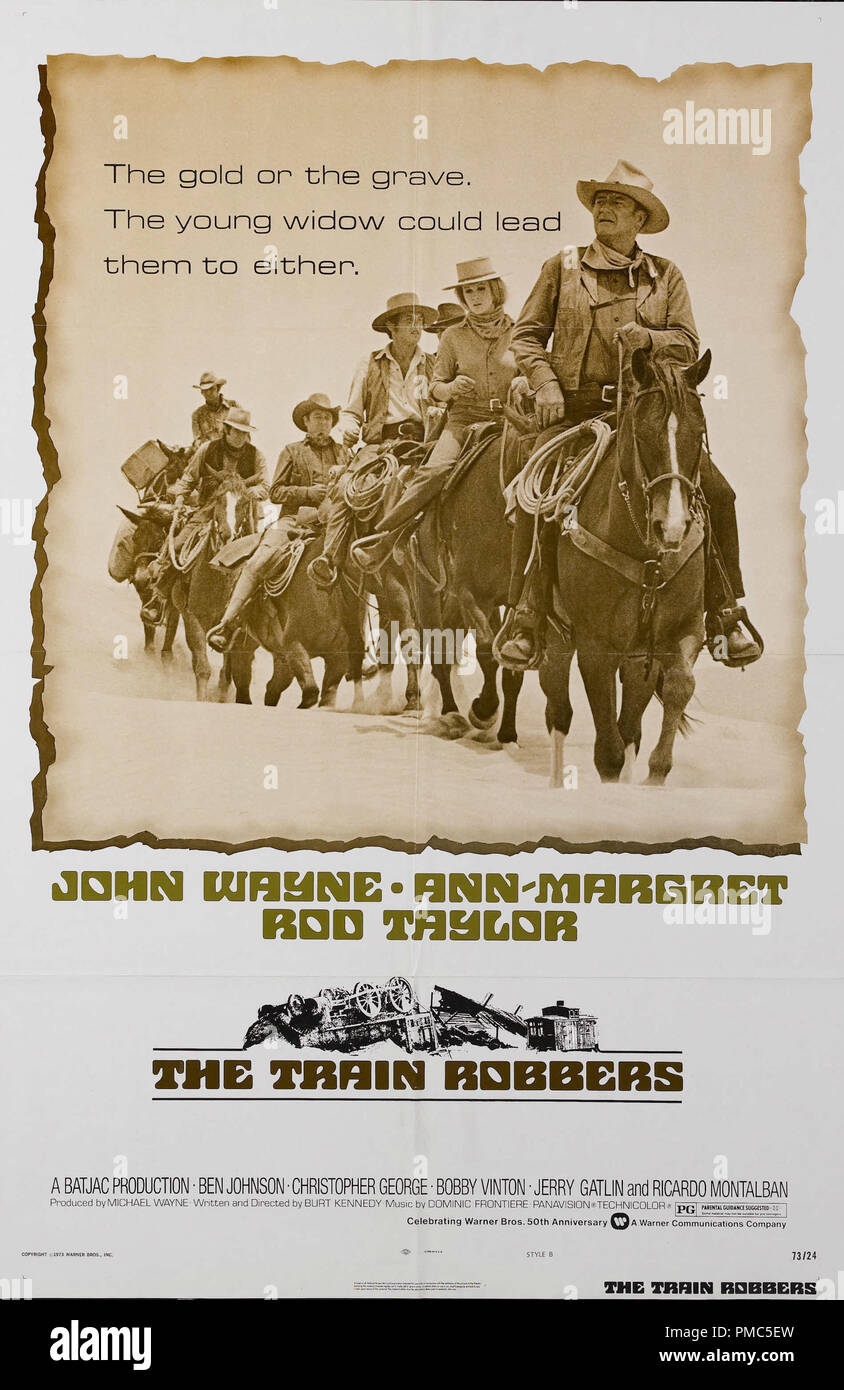 Ann-Margret, John Wayne,  The Train Robbers (Warner Brothers, 1973). Poster  File Reference # 33635_019THA - Stock Image