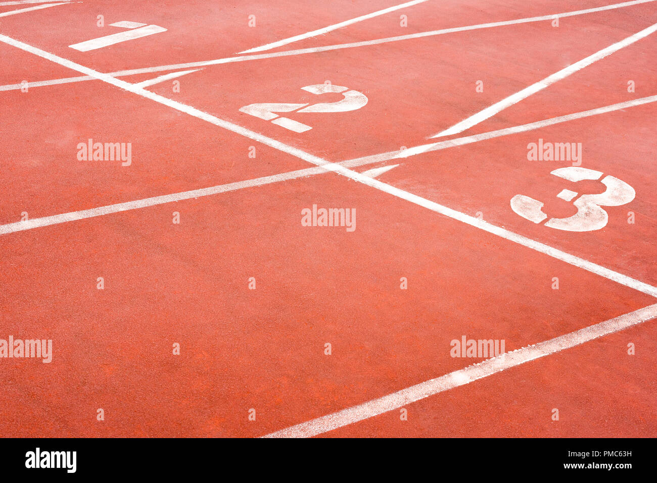 1 2 3 Orange athletic tracks close-up in a stadium - Stock Image