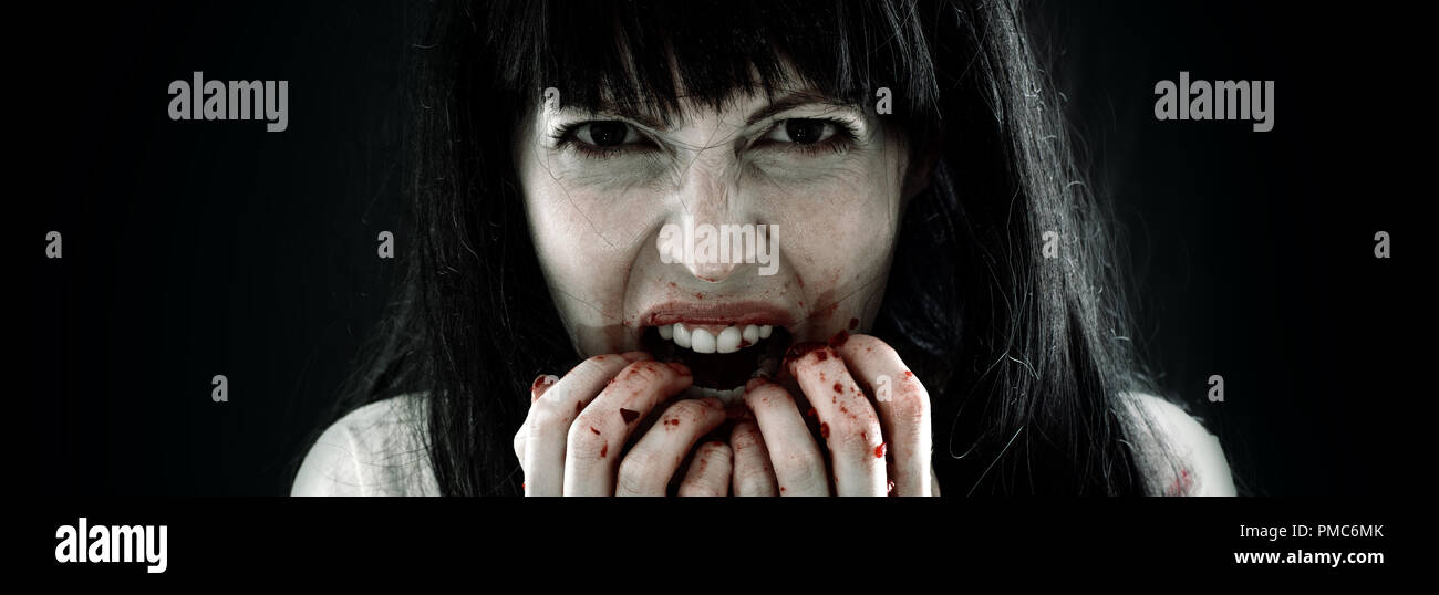 Halloween horror. Crazy bloody scary zombie woman Stock Photo