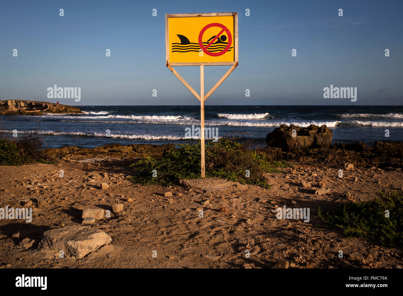 A sign to ward off swimmers against possible shark attacks is pictured inside the African Union Mission in Somalia (AMISOM) base in Mogadishu, Somalia - Stock Image